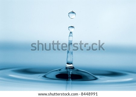 isolated water drop with rippling water and tower of water - stock photo