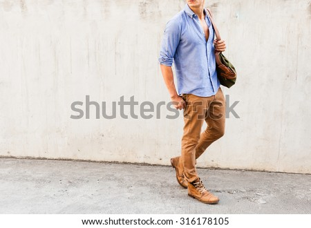 Isolated well dressed male fashion model.  - stock photo
