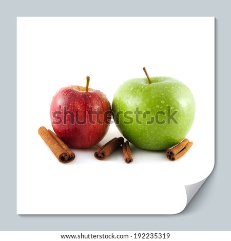 Isolated wet green and red apple with cinnamon pods on a white background. Fresh diet fruit. Healthy fruit with vitamins.