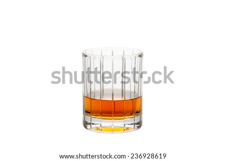 Isolated Whiskey Glass - Crystal glass containing whiskey, bourbon, or other amber liquor.  Isolated on white. - stock photo