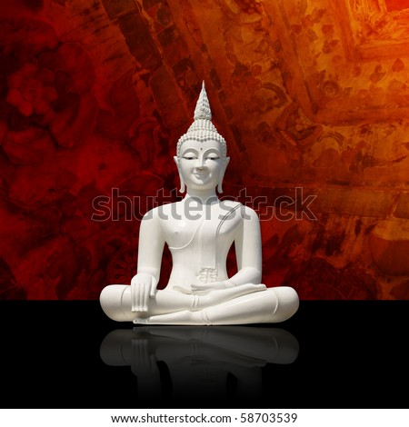 Isolated white buddha against colorful background (incl. clipping path) - stock photo
