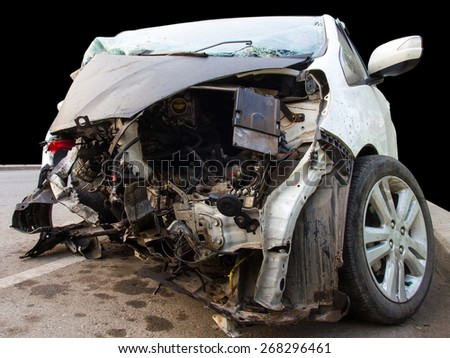 Isolated white car in front has been damaged by accident, hit a tree. - stock photo