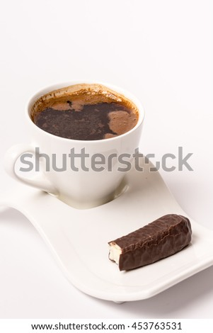 Isolated white cup of coffee with chocolate banana cookie