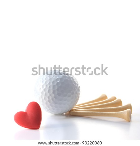 "Isolated white golf ball with wooden tees on white with red heart. Concept Father's Day theme incorporating ""I love golf"" message. Square crop. Copy space. - stock photo"