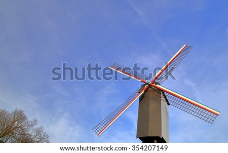Isolated wind mill under the blue sky, Bruges, Belgium