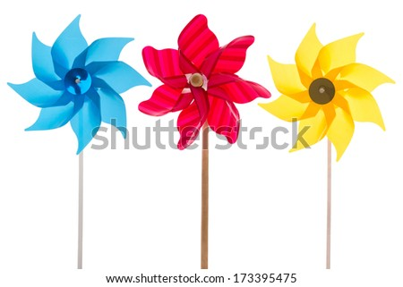 Isolated windmills in blue, pink and yellow on a white background for gardening