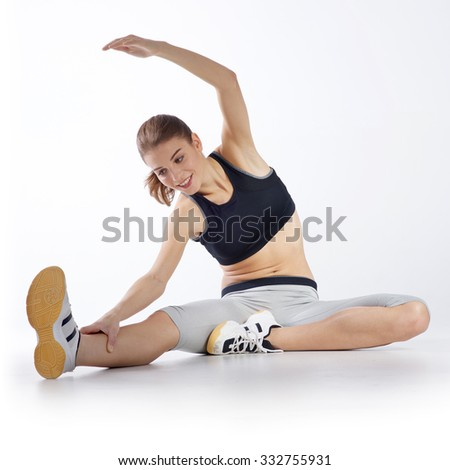Isolated woman doing fitness exercises on white background - stock photo