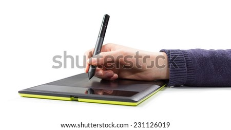 isolated woman hand draws a pen on a touch tablet - stock photo