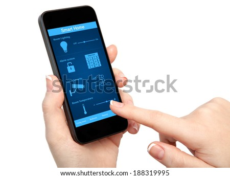 isolated woman hand holding the phone with system smart house - stock photo