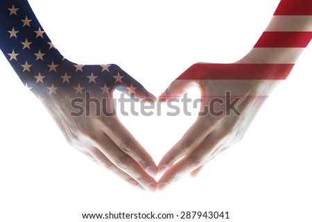 Isolated woman human hands in heart shaped form with the United States of America flag pattern overlay on white background: USA Independence day, columbus day, labor day and flag day concept  - stock photo