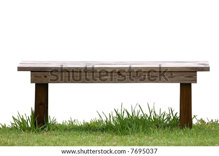 Isolated wood bench on green grass. - stock photo