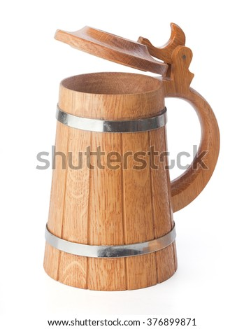 Isolated wooden beer mug with cap on the white