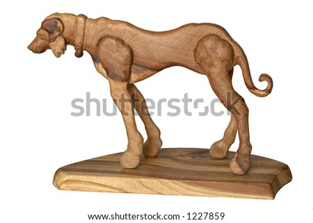 Isolated wooden dog on pedestal. Year of the Dog