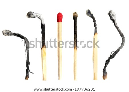 isolated wooden match and burned matches - stock photo