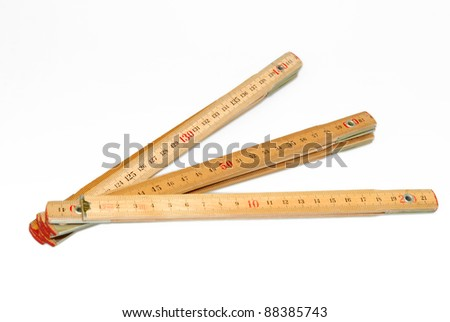 isolated wooden open folding rule - stock photo