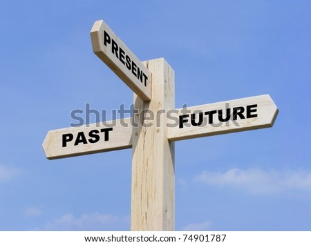 Isolated wooden signpost with the text past, present and future - stock photo