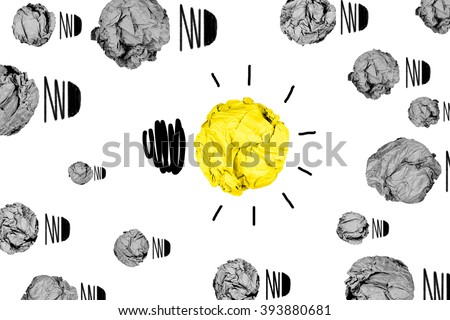 isolated yellow crumpled paper light bulb with white background creative inspiration concept  metaphor for think different idea concept /another direction / think other way / creative from different  - stock photo