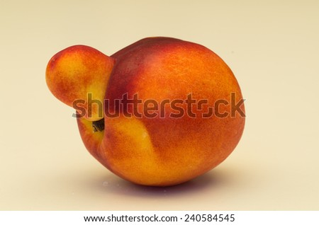 Isolated yellow nectarines against a white background, with some nectarines being mutated. - stock photo
