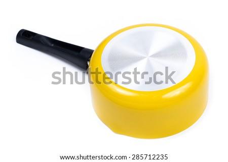 Isolated yellow pan - stock photo