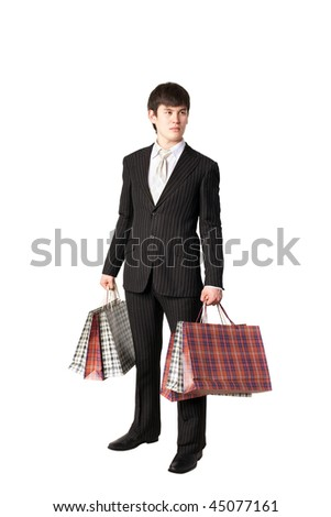 Isolated young asian man carrying shopping bags - stock photo