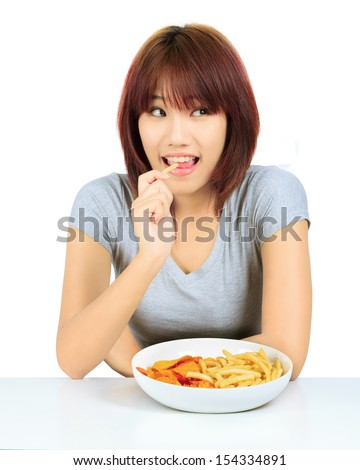 Isolated young asian woman with a plate of potato chips and french fries
