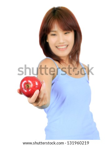 Isolated young asian woman with a red apple. - stock photo