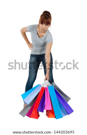 Isolated young asian woman with colorful shopping bags - stock photo