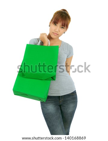 Isolated Young Asian woman with Green Shopping Bags - stock photo