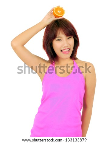 Isolated young asian woman with pieces of orange - stock photo