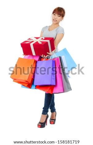 Isolated young Asian woman with shopping bags