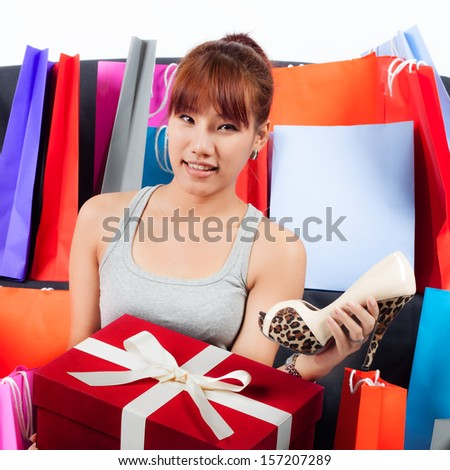 Isolated Young Asian woman with Shopping Bags and a new Shoes - stock photo