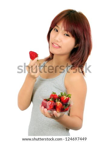 Isolated young asian woman with strawberry
