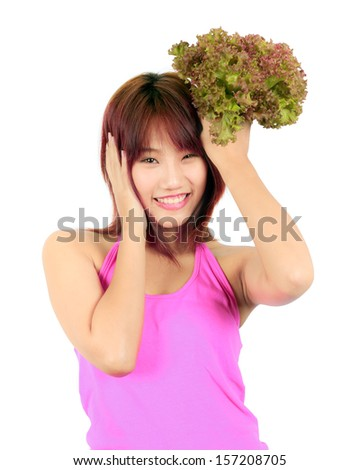 Isolated young asian woman with vegetable  - stock photo