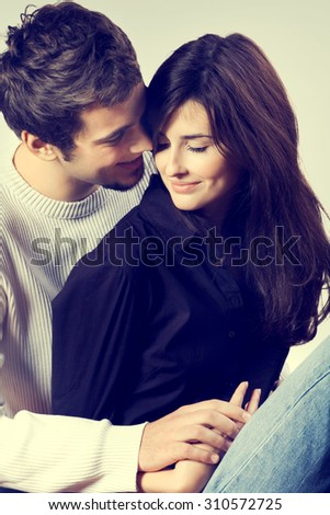 Isolated young attractive happy smiling amorous couple embracing  - stock photo