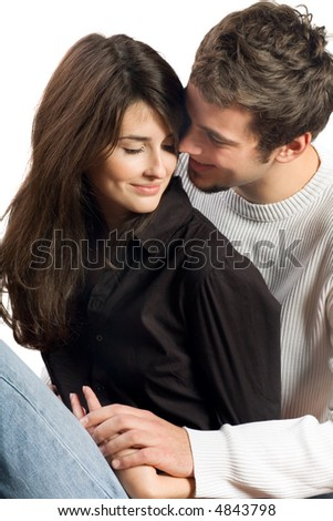 Isolated young attractive happy smiling amorous couple embracing