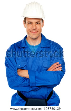 Isolated young attractive repairman posing with style - stock photo