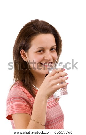 Isolated young beautiful woman drinking water