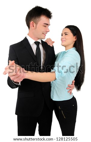 Isolated young business couple dance
