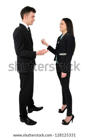 Isolated young business couple talk - stock photo