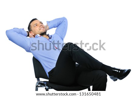 Isolated young business man relaxing on chair - stock photo