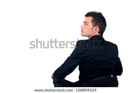 Isolated young business man sitting on chair