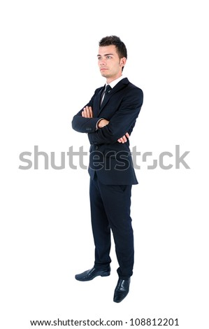 Isolated young business man standing