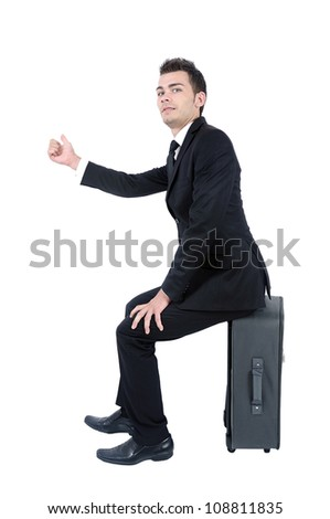 Isolated young business man thumb a ride