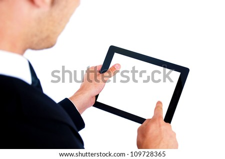 Isolated young business man using tablet