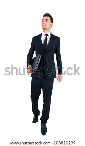 Isolated young business man walking - stock photo