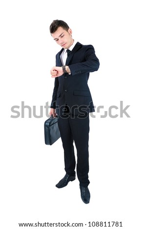Isolated young business man watching at clock