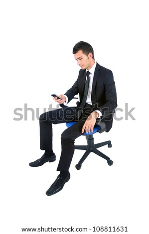 Isolated young business man with phone