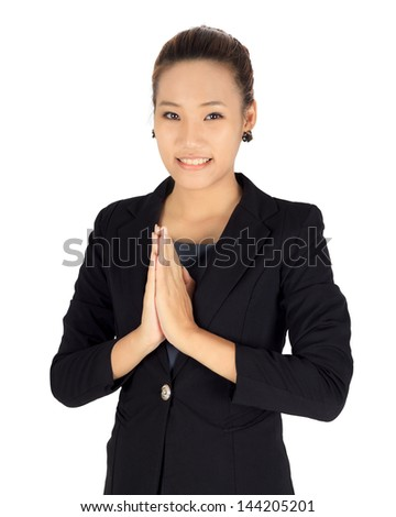 Isolated young business with Thai paying respect posture - stock photo