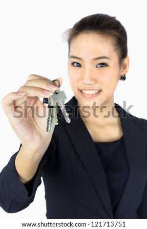 Isolated Young  Business woman holds the keys in her hand.