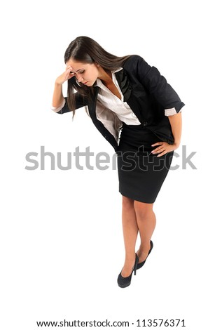 Isolated young business woman looking down - stock photo